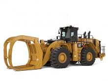 Колесный погрузчик большой мощности 990K для лесозаготовки.